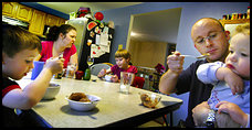 Fairfax residents Christine and George Lively, pictured here with their children, Carl, 4, Georgia Mae, 8, and Lance, 21 months, say they have people over more often for dinner than they are invited to others' homes.